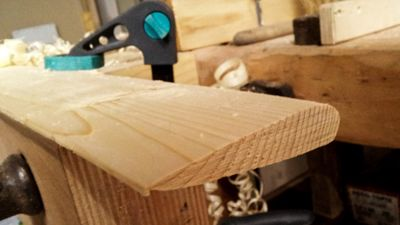 Work in progress photo of a wooden NACA airfoil made with a table saw and a planer out of spruce